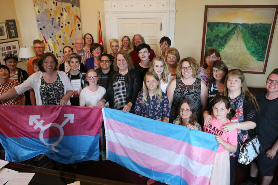 Transgender rights advocates celebrate in Sen. Mitchell's office after Bill C-16 is adopted at third reading in the Senate on June 15, 2017. (Photo: Greg Kolz)