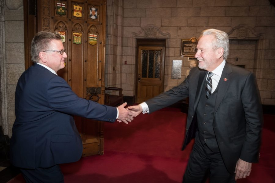 Senator Peter Harder (right) welcomes Senator Robert Black (left) to the Red Chamber for the first time.